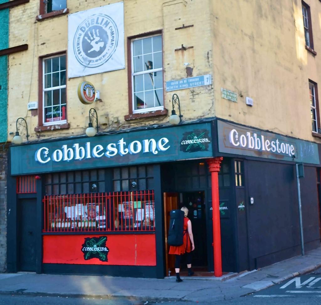 The rough, window-barred exterior of the Cobblestone Pub