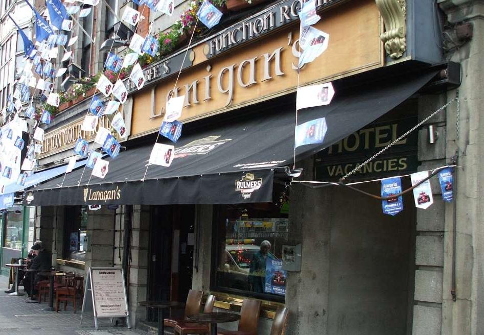 The flag-adorned exterior of Lanigan's Pub