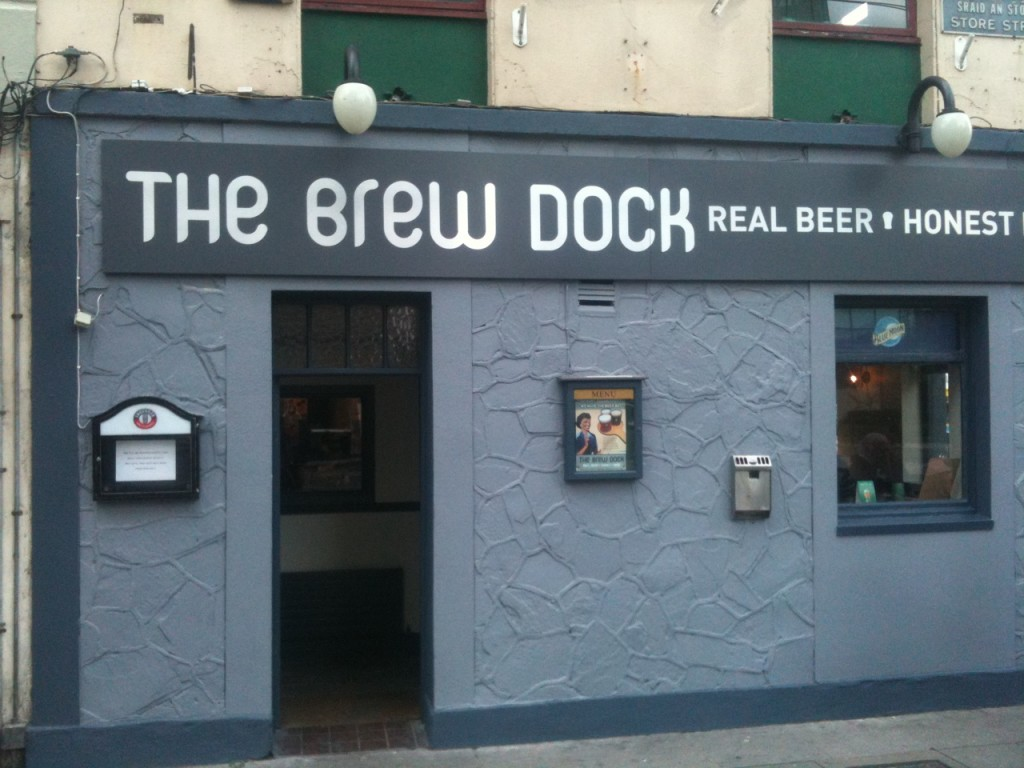 The Brew Dock pub's exterior is simple in grey